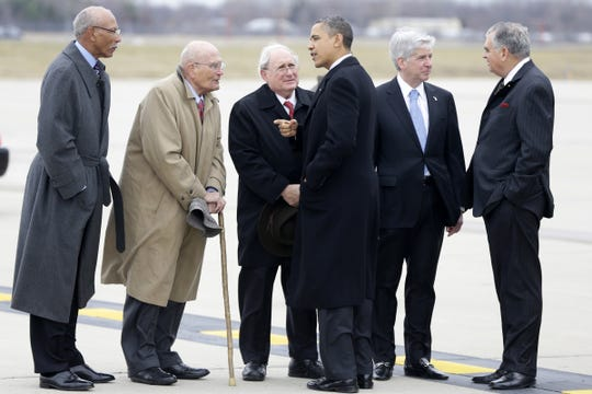 President Barack Obama and Transportation Secretary Ray LaHood, right, are met by, from left: Detroit Mayor Dave Bing; Rep. John Dingell, D-Mich.; Sen. Carl Levin, D-Mich., and Michigan Gov. Rick Snyder, after stepping off Air Force One upon his arrival at  Metropolitan Wayne County Airport in Detroit, Monday, Dec. 10, 2012, before going to the Daimler Detroit Diesel plant in Redford, Mich.