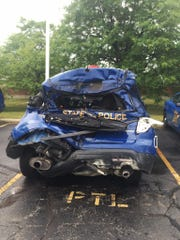 A Michigan State Police trooper was seriously injured in a crash in Southfield after his SUV patrol vehicle was struck by a large construction van on July 25, 2016.