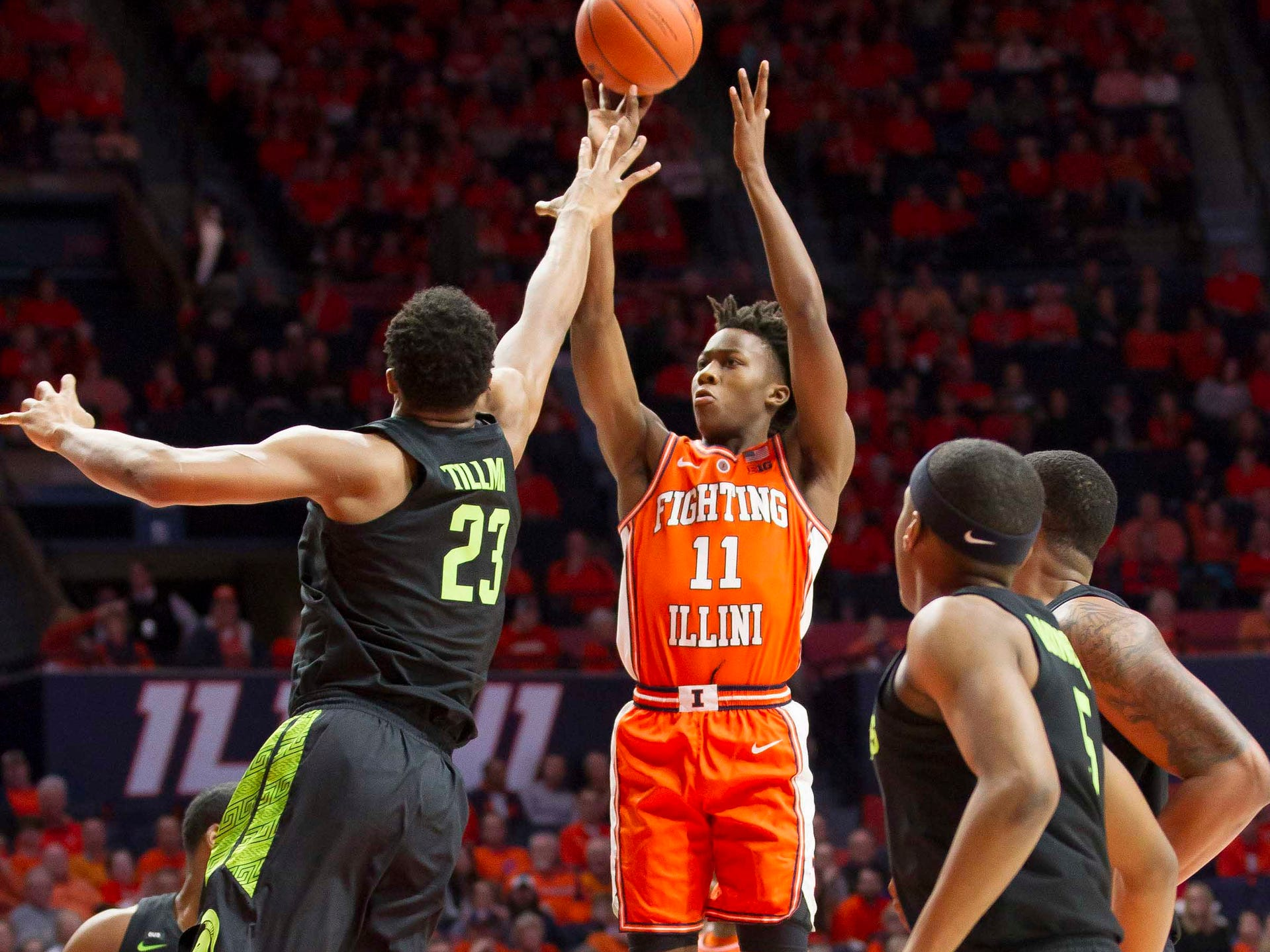 Illinois Fighting Illini guard Ayo Dosunmu (11) shoots defended by Michigan State Spartans forward Xavier Tillman (23) during the first half at State Farm Center on Tuesday, Feb. 5, 2019.