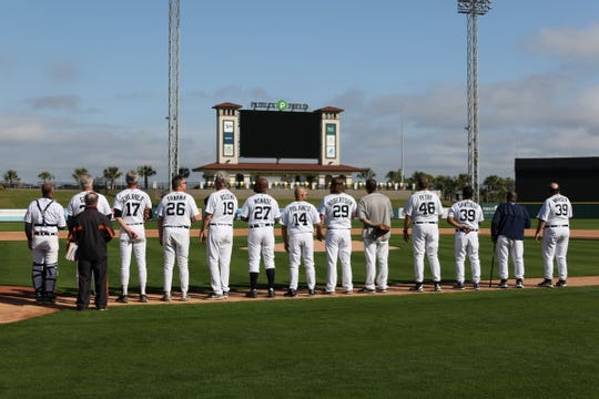 Former Detroit Tigers players line up for the national anthem before Saturday's fantasy camp finale at Joker Marchant Stadium.
