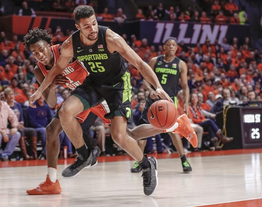 Ayo Dosunmu #11 of the Illinois Fighting Illini and Kenny Goins #25 of the Michigan State Spartans chase down the ball during the first half of the game at State Farm Center on February 5, 2019 in Champaign, Illinois.