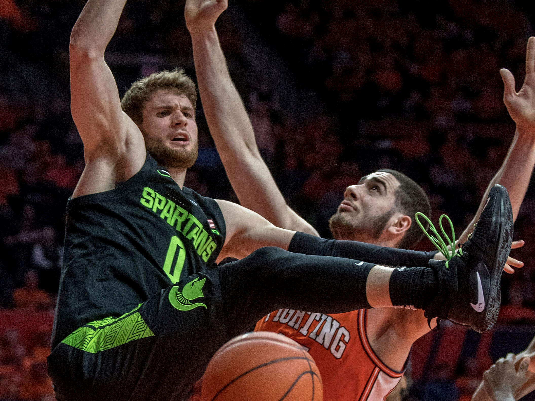 Michigan State forward Kyle Ahrens collides with Illinois forward Giorgi Bezhanishvili after trying to shoot during the second half of MSU's 79-74 loss to Illinois on Tuesday, Feb. 5, 2019, in Champaign, Ill.