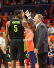 Michigan State Spartans head coach Tom Izzo has a discussion with guard Cassius Winston (5) during the first half against the Illinois Fighting Illini at State Farm Center.