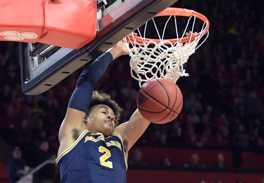 Michigan guard Jordan Poole dunks the ball during the first half of U-M's 77-65 win on Tuesday, Feb. 5, 2019, in Piscataway, N.J.