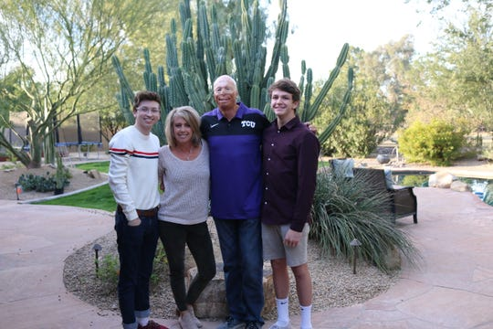 Jason Schechterle, 46, is pictured in on Christmas Eve 2018 with (left to right) his son Zane, wife Suzie, and son Masen in the family's backyard in Phoenix. The retired law enforcement officer is an inspirational speaker who flew to Detroit in January 2019 to speak to the AXA Advisors Great Lakes group in Rochester.