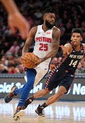 Pistons guard Reggie Bullock dribbles the ball against Knicks guard Allonzo Trier during the second quarter of the Pistons' 105-92 win on Tuesday, Feb. 5, 2019, in New York.