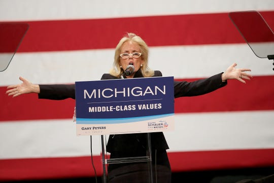 Debbie Dingell ran for her husband John Dingell's seat after he retired. In this photo, Dingell speaks during the Michigan Democratic Party Campaign rally with special guest First Lady Michelle Obama on Friday, Oct. 10, 2014 at the Detroit Music Hall Center for Performing Arts in Downtown Detroit.