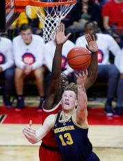 Michigan Wolverines forward Ignas Brazdeikis (13) goes to the basket against Rutgers Scarlet Knights forward Eugene Omoruyi (5) during the first half at Rutgers Athletic Center (RAC) on February 5, 2019.