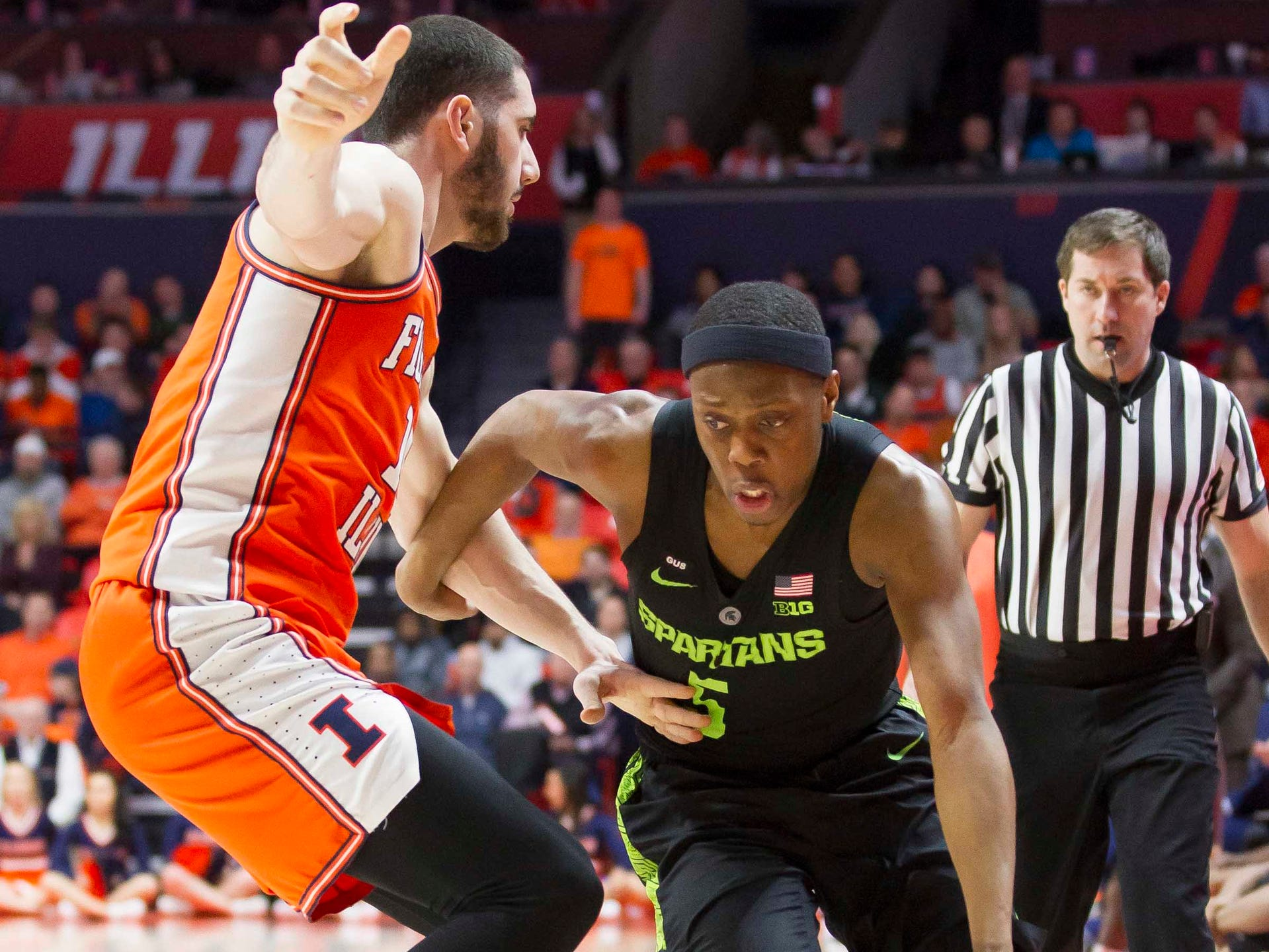 Michigan State guard Cassius Winston drives past Illinois forward Giorgi Bezhanishvili during the second half of MSU's 79-74 loss to Illinois on Tuesday, Feb. 5, 2019, in Champaign, Ill.