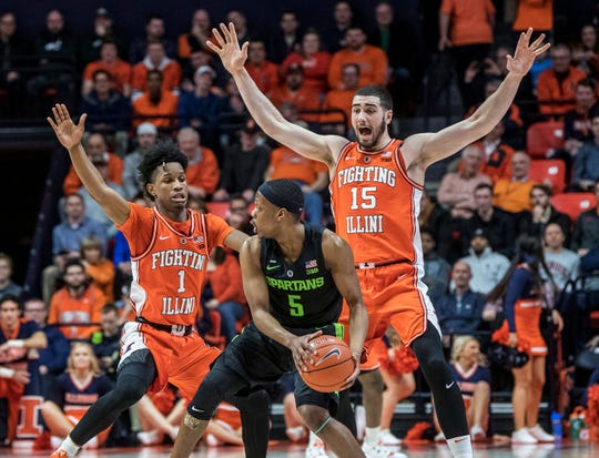 Illinois guard Trent Frazier (1) and forward Giorgi Bezhanishvili (15) pressure Michigan State guard Cassius Winston (5) during the first half of an NCAA college basketball game in Champaign, Ill., Tuesday, Feb. 5, 2019.