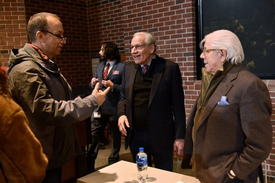 "Charlie Frakes, from left, talks with Bob Woodward and Carl Bernstein after a Q&A at the University Center at Macomb Community College in Clinton Township on Wednesday. ""These guys are heroes,"" he said at the event."