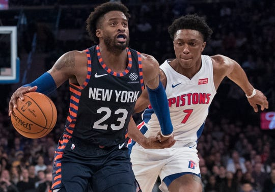 Knicks guard Wesley Matthews drives to the basket against Pistons forward Stanley Johnson.