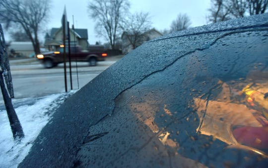 Up to 3/8 of an inch of ice was scraped off the windshield of a Detroit News photographer's 2011 Chevy Avalanche during a Wednesday ice storm that closed schools and led to traffic accidents in southeast Michigan.