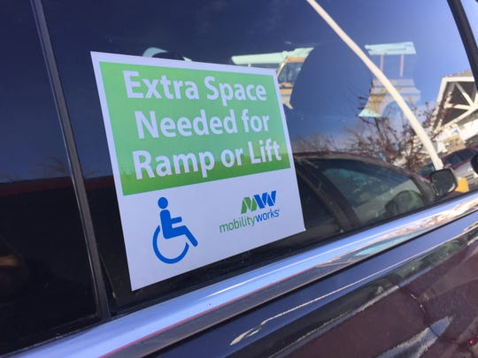 Parking in the striped lines near a handicapped spots may make it hard for someone to lower a wheelchair lift.