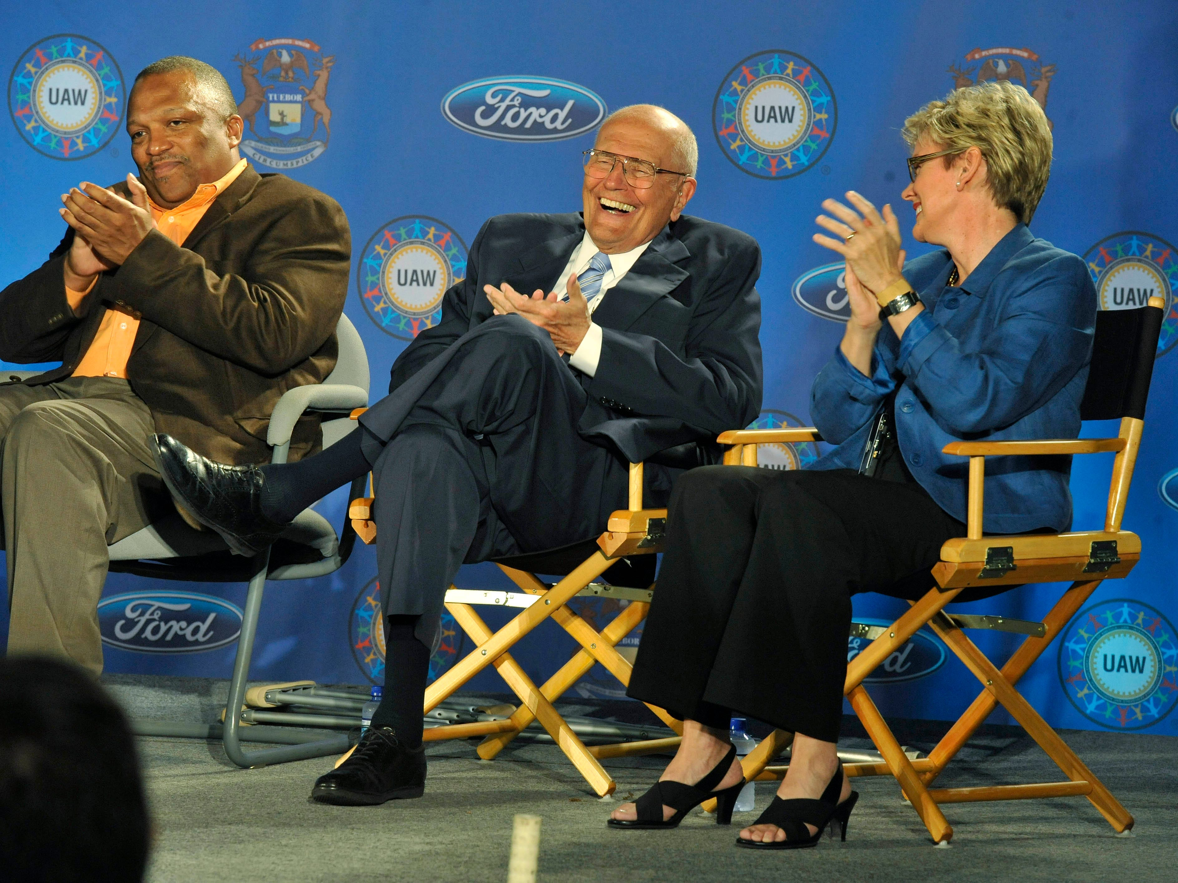 Dingell shares a laugh with Michigan Gov. Jennifer Granholm and UAW official Chuck Hall during an announcement  an concerning electric vehicles at the Ford Rawsonville Plant in Ypsilanti on May 24, 2010.