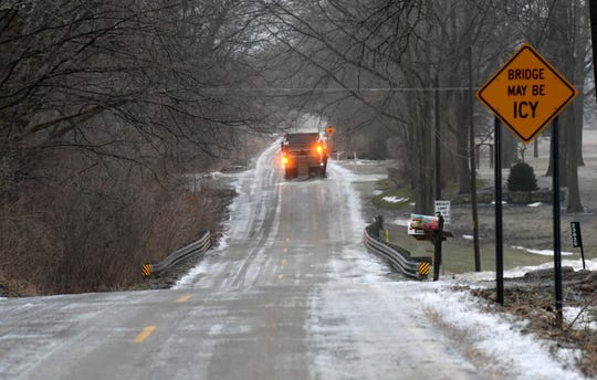 A Macomb County Department of Roads plow truck spreads salt on 33 Mile westbound approaching North Avenue in Armada Twp. Wednesday morning.