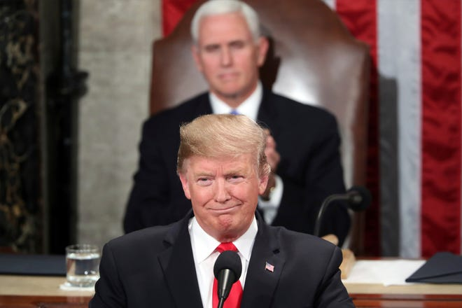 President Donald Trump delivers his State of the Union address to a joint session of Congress on Capitol Hill in Washington, as Vice President Mike Pence watches, Tuesday, Feb. 5, 2019.