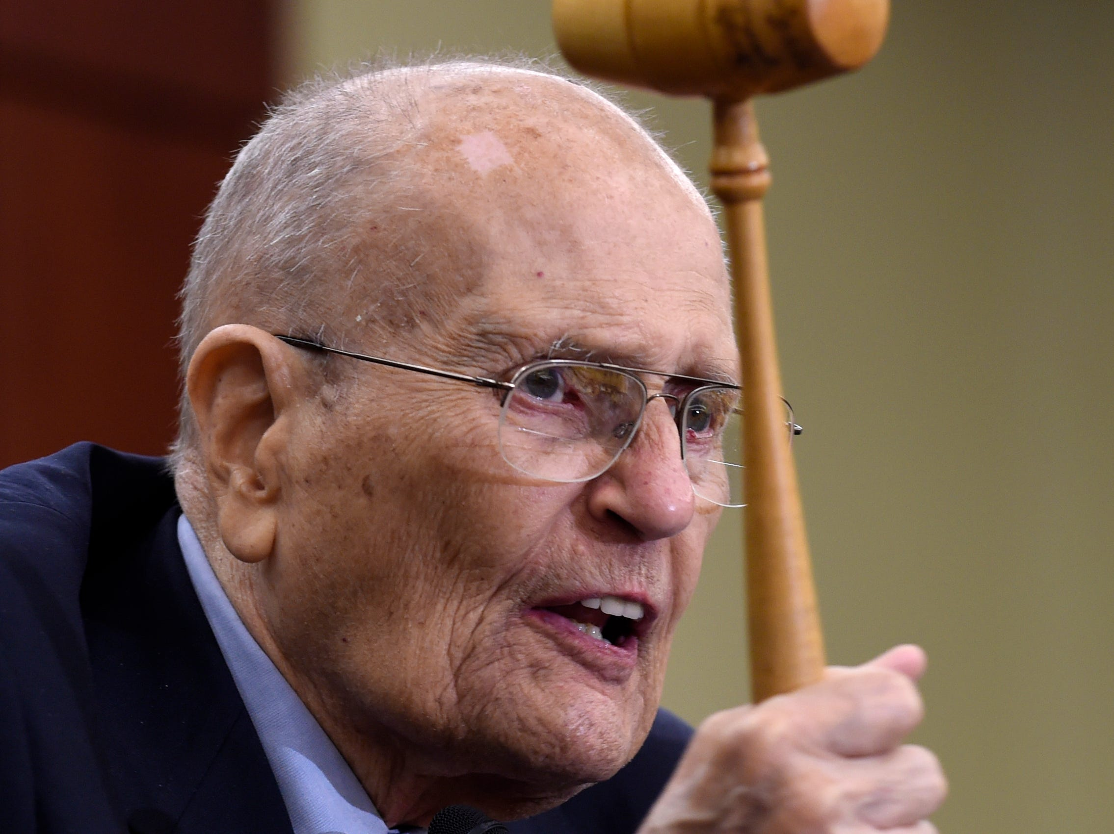 Former Michigan Rep. John Dingell holds up the gavel he used 50 years ago when Medicare legislation was passed, as he speaks at an event marking the 50th anniversary of Medicare and Medicaid,  July 29, 2015, on Capitol Hill.