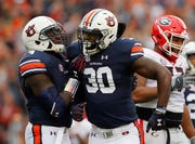 The Lions signed former Auburn linebacker Tre' Williams on Wednesday.