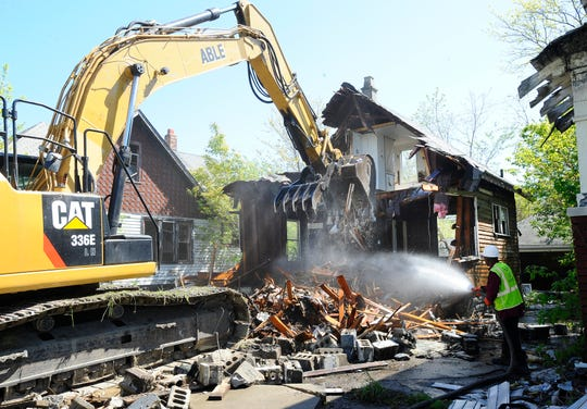 FILE -- Demolition of an unoccupied house at 9724 Hayes in Detroit, Michigan on May 19, 2016.