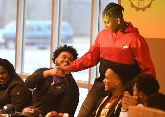 Cass Tech High School's Jaylen Billings shakes hands with teammate James Ester after Ester announces he will be attending Northern Illinois University.