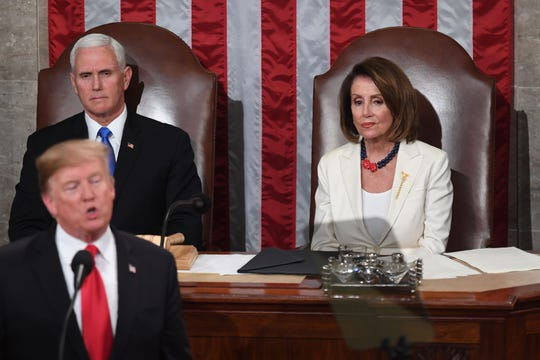 US Vice President Mike Pence and Speaker of the US House of Representatives Nancy Pelosi (R) listen to US President Donald Trump deliver the State of the Union address at the US Capitol in Washington, DC, on February 5, 2019.