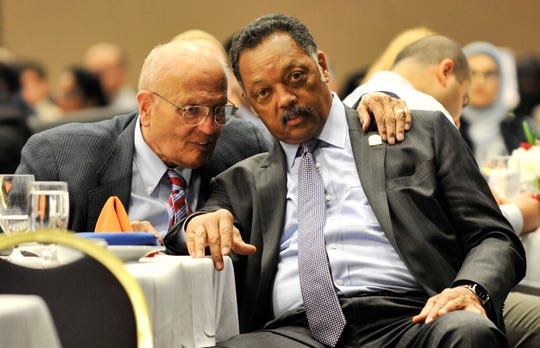 Dingell talks with Rev. Jesse Jackson, president of the Rainbow/PUSH Coalition,  at the 10th annual fundraising banquet for the Council on American Islamic Relations Michigan chapter at the Hyatt Regency in Dearborn on March 28, 2010.
