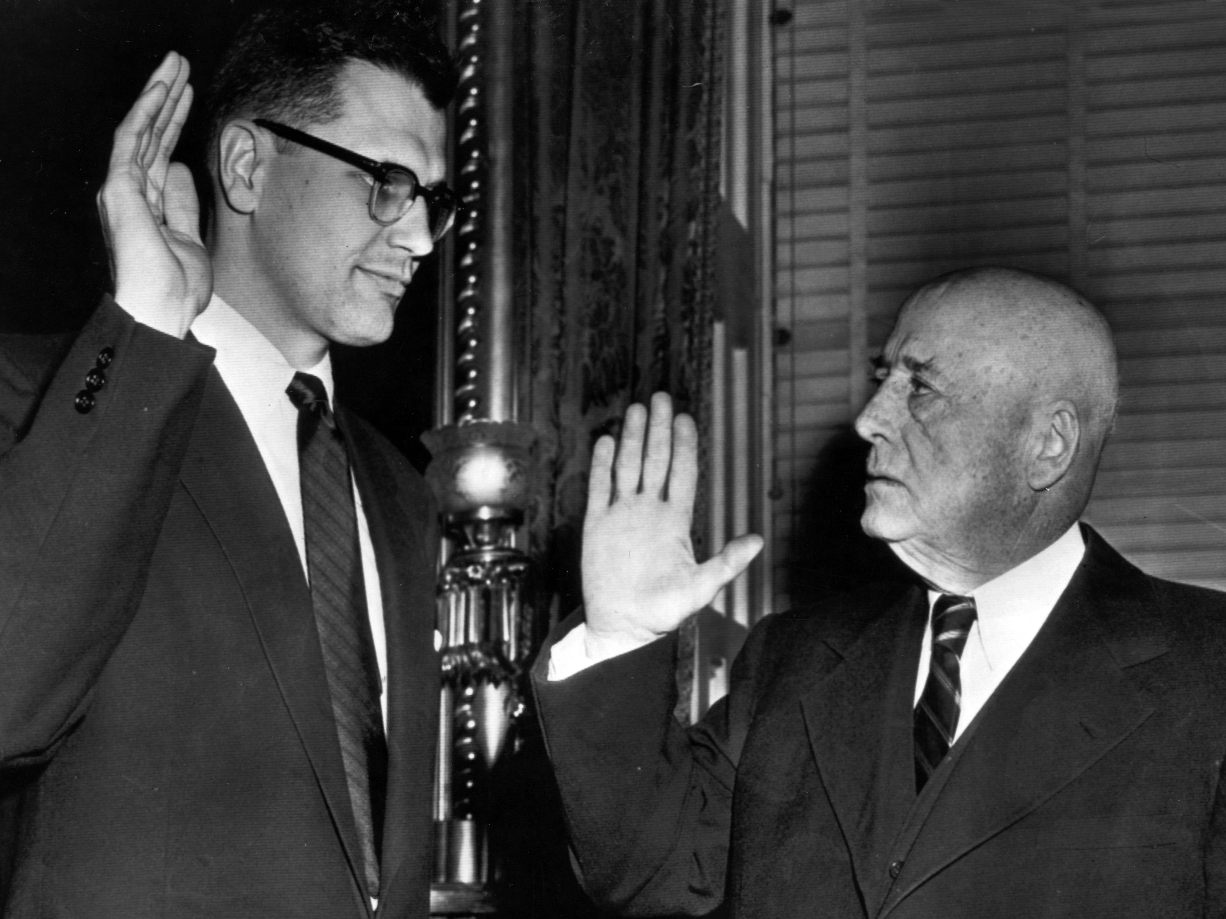 In 1955, John Sr. died and John Jr. won a special election to succeed him in the U.S. House.  Above, Dingell is sworn in as a Congressman in 1956.