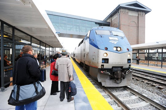 A Chicago bound train arrives after the dedication of the John Dingell Transit Center in Dearborn, December 15, 2014.