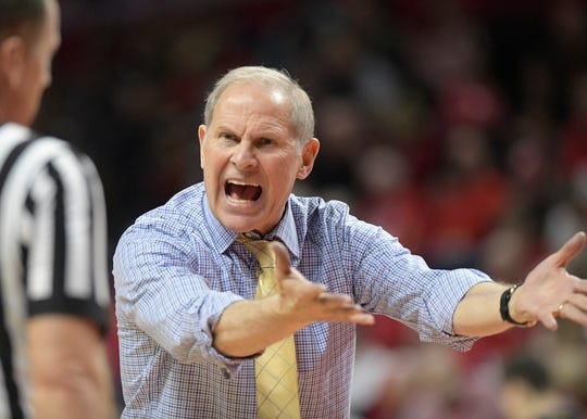 Michigan coach John Beilein talks to the referee during the second half.
