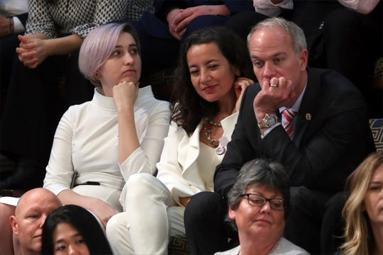 Amanda Thomashow, left, a guest of Rep. Elissa Slotkin, D-Mich., listens as President Donald Trump delivers his State of the Union address to a joint session of Congress on Capitol Hill in Washington, Tuesday.