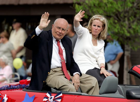 Dingell and his wife Debbie wave to paradegoers during the 84th Annual Memorial Day Parade, May 26, 2008 in downtown Dearborn.