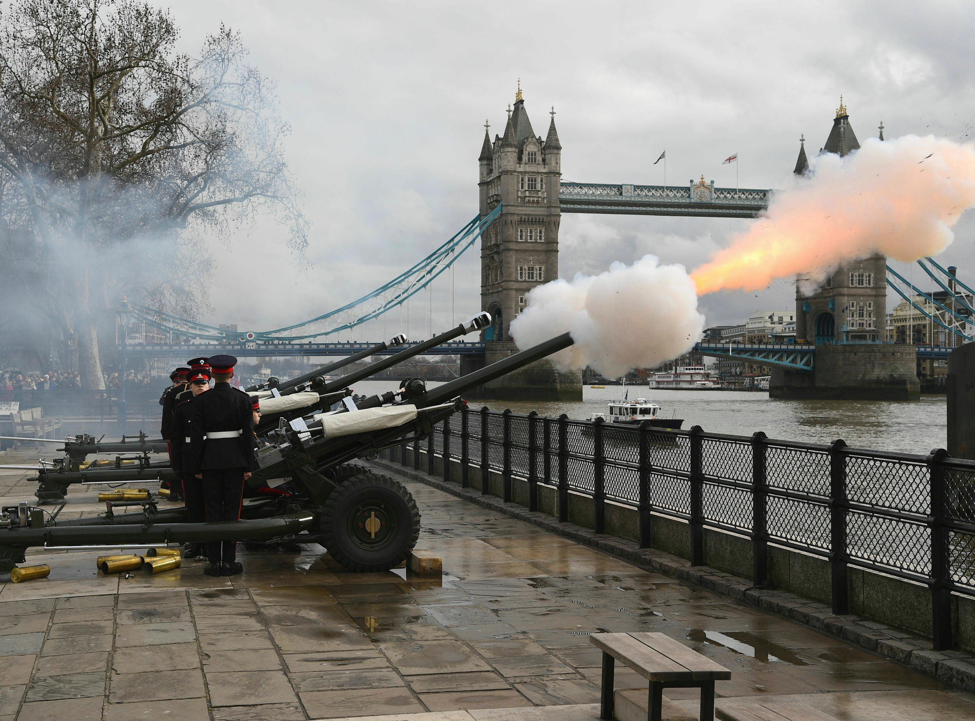 Members of the Honourable Artillery Company fire a 62-round gun salute from the wharf at the Tower of London, with Tower Bridge in background, to mark the anniversary of the succession of Queen Elizabeth II to the throne, Wednesday Feb. 6, 2019.  Princess Elizabeth acceded to the throne Feb. 6, 1952, on the death of her father King George VI.