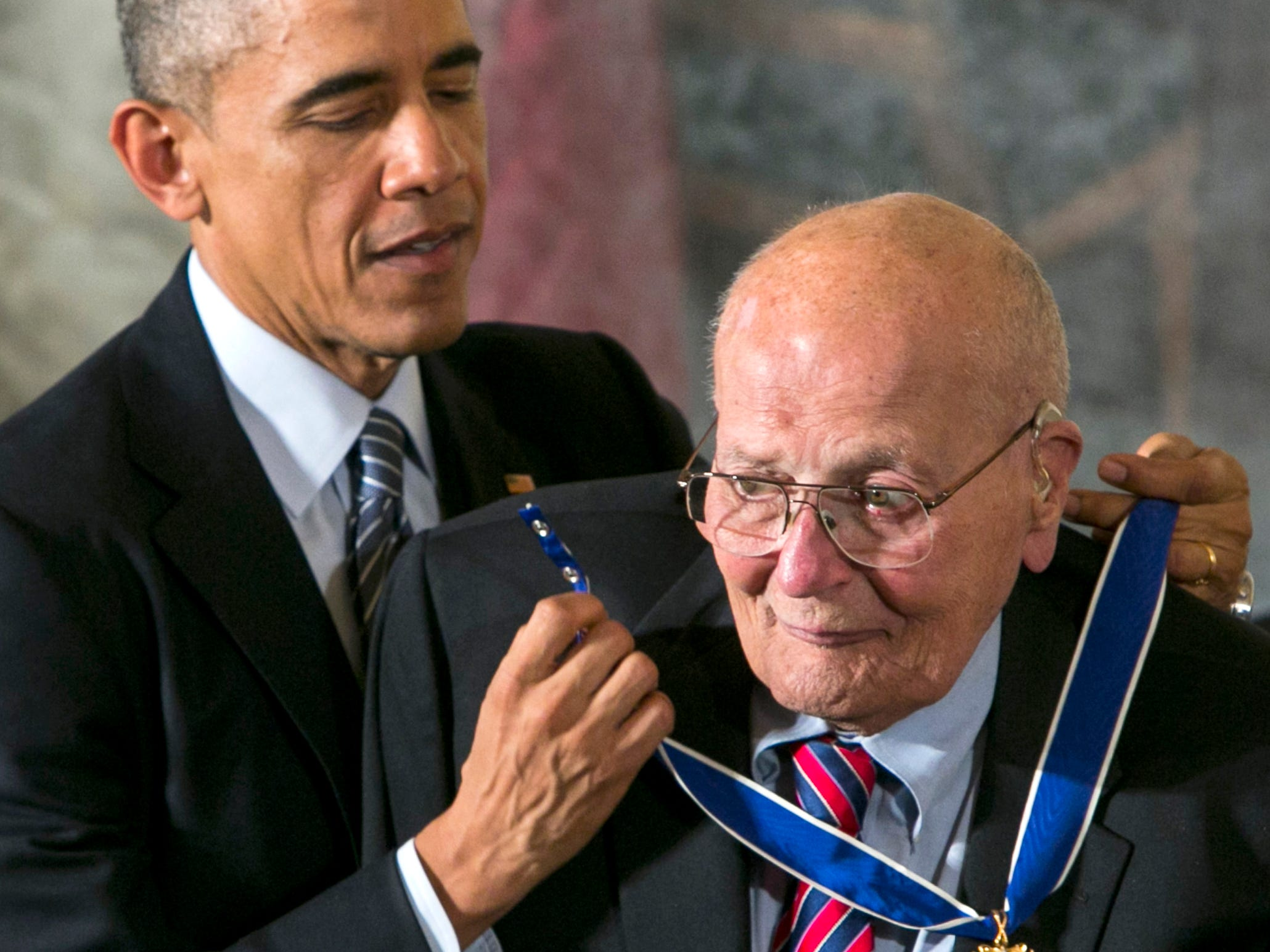 "President Barack Obama awards Rep.  John Dingell Jr. the Presidential Medal of Honor at the White House on November 24, 2014. It is the nation's highest civilian honor, presented to individuals who have made especially meritorious contributions to the security or national interests of the United States.  Obama described Dingell as ""one of the most influential legislators of all time."""