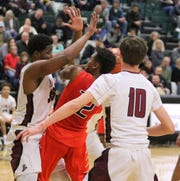 Jaquan Pinckney of Binghamton is sandwiched between Elmira's Markel Jenkins, left, and Nolan Collins (10) as he looks for room inside Feb. 5, 2019 at Elmira High School.