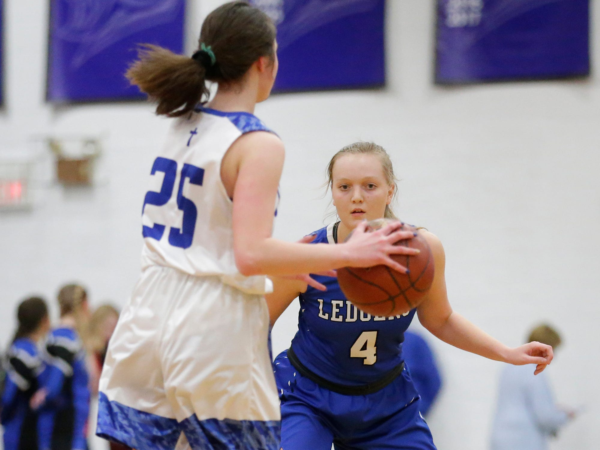 St. Mary's Springs Academy girls basketball's Brianna Freund defends Winnebago Lutheran Academy's Geneva Hewitt during their game Tuesday, February 5, 2019 in Fond du Lac, Wisconsin. Winnebago Lutheran won the game 44-35. Doug Raflik/USA TODAY NETWORK-Wisconsin