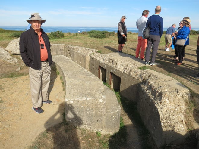 Bob Rundle stands in a bunker at Normandy, France. He and a tour group from Fond du Lac recently took in the sights, 75 years after D-Day.