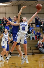 Winnebago Lutheran's Kalli Wiechman reaches for a rebound against St. Mary's Springs during Tuesday's game.