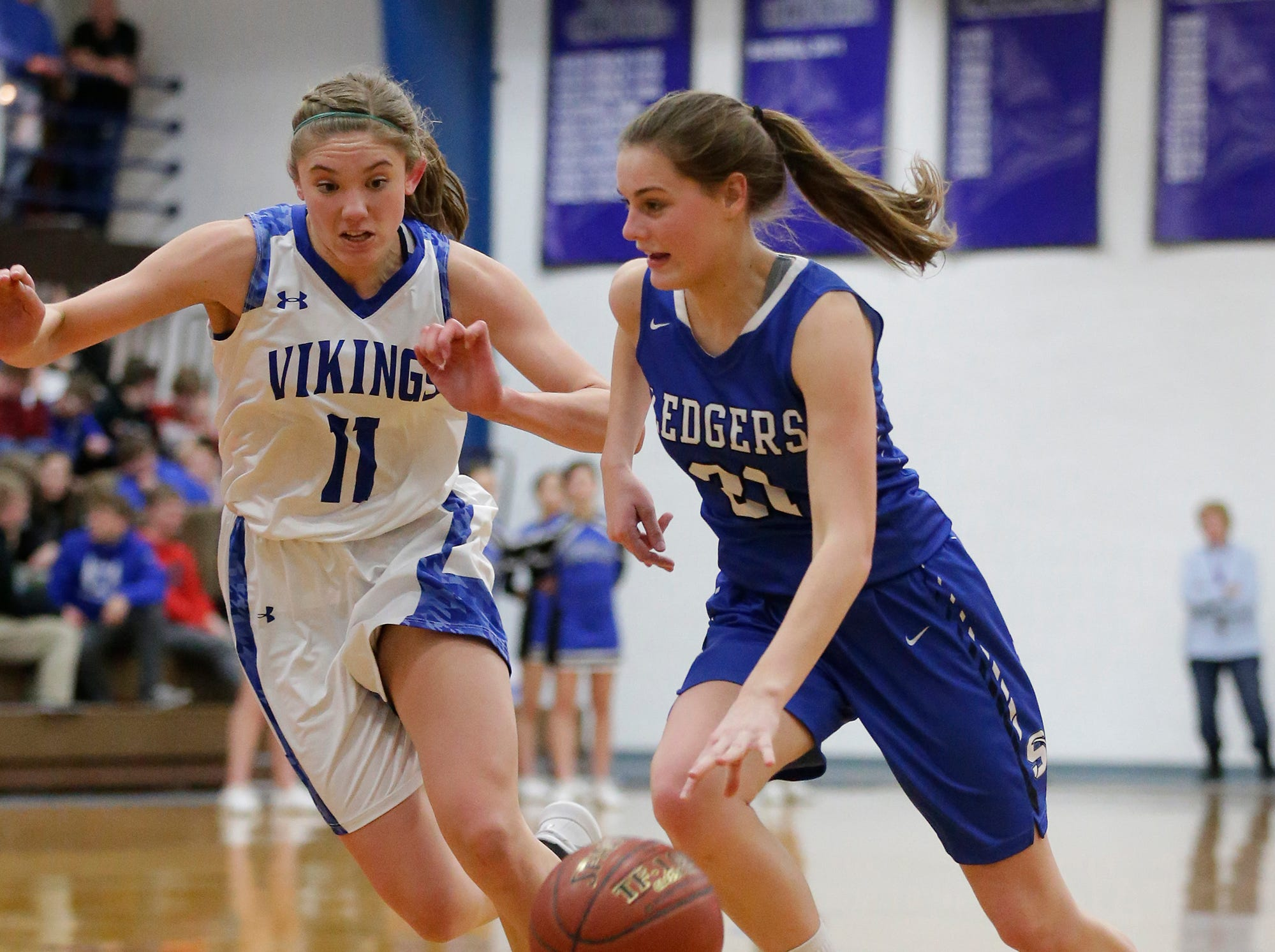 St. Mary's Springs Academy girls basketball's Jennifer Chatterton drives down court while Winnebago Lutheran Academy's Alyssa Lorenz defends her during their game Tuesday, February 5, 2019 in Fond du Lac, Wisconsin. Winnebago Lutheran won the game 44-35. Doug Raflik/USA TODAY NETWORK-Wisconsin