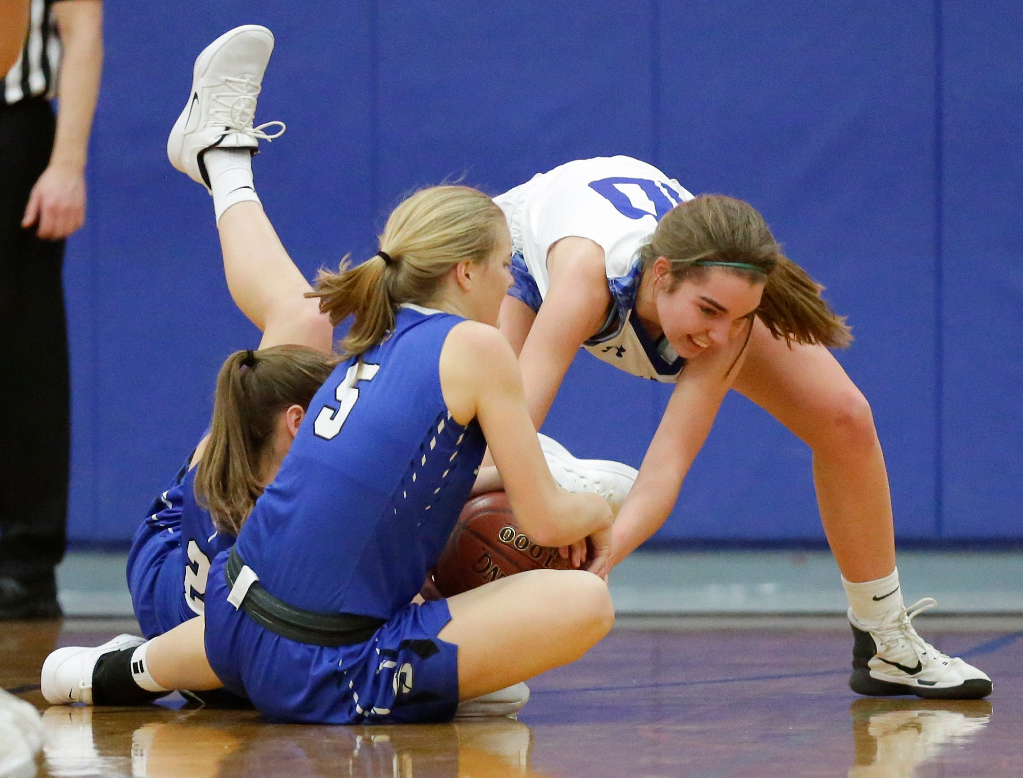 Winnebago Lutheran Academy girls basketball's Kalli Wiechman battles for a loose ball with St. Mary's Springs Academy's Jennifer Chatterton (21) and Gracie Rieder (5) during their game Tuesday, February 5, 2019 in Fond du Lac, Wisconsin. Winnebago Lutheran won the game 44-35. Doug Raflik/USA TODAY NETWORK-Wisconsin