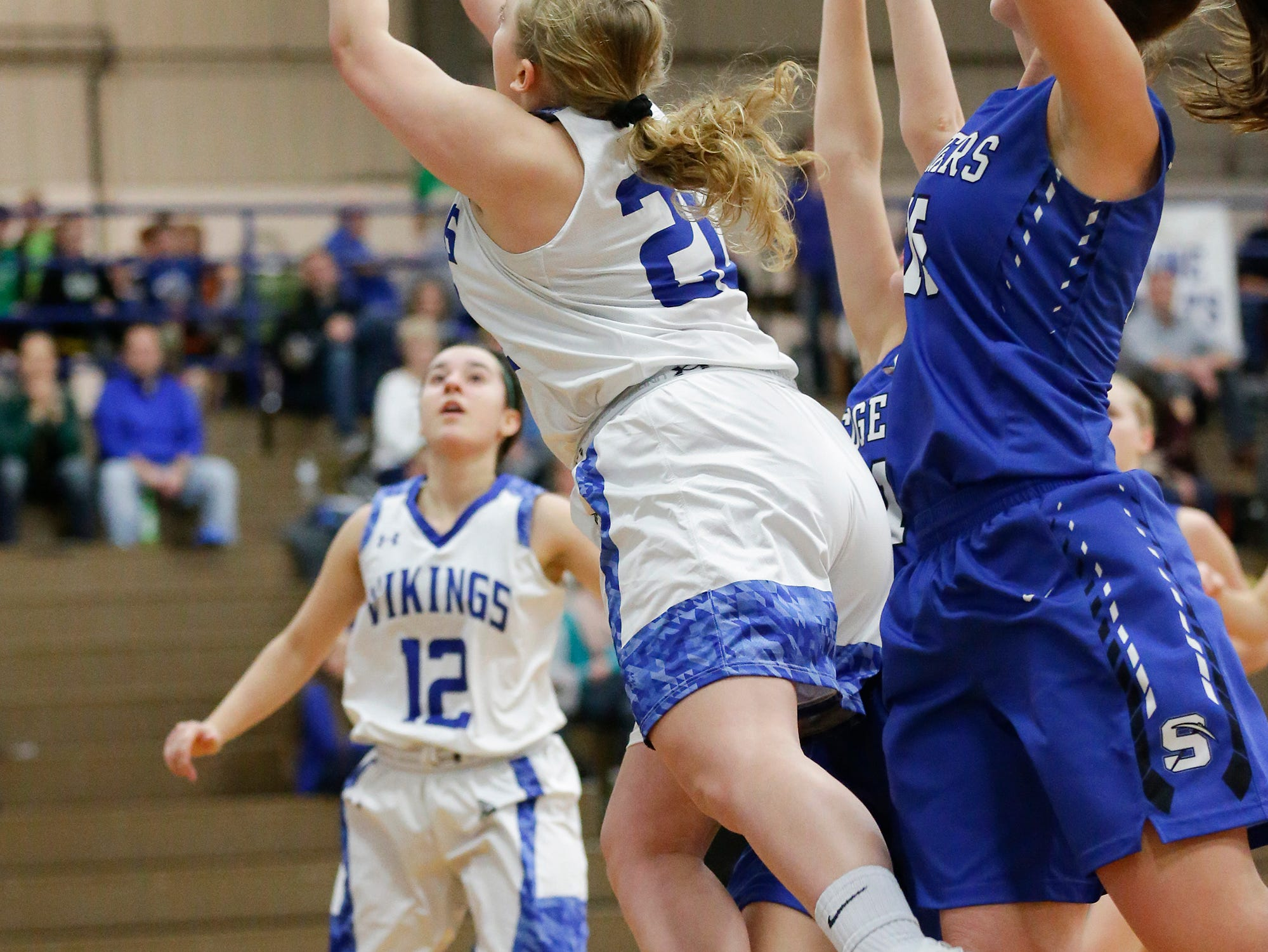 Winnebago Lutheran Academy girls basketball's Rebecca Honaker gets tripped up as she makes an attempt at a basket against St. Mary's Springs Academy during their game Tuesday, February 5, 2019 in Fond du Lac, Wisconsin. Winnebago Lutheran won the game 44-35. Doug Raflik/USA TODAY NETWORK-Wisconsin