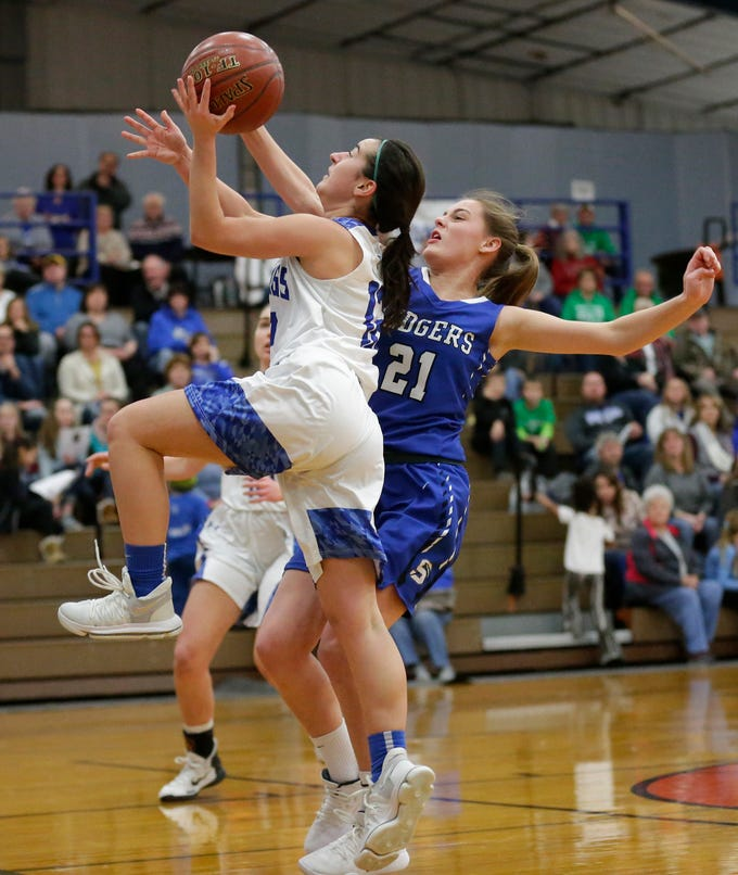 St. Mary's Springs Academy girls basketball's Jennifer Chatterton fouls Winnebago Lutheran Academy's Katelyn Bonilla during their game Tuesday, February 5, 2019 in Fond du Lac, Wisconsin. Winnebago Lutheran won the game 44-35. Doug Raflik/USA TODAY NETWORK-Wisconsin