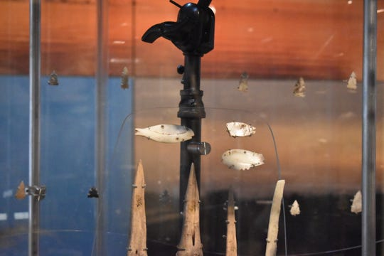 Fish decoys used in sturgeon spearfishing are displayed at the Oshkosh Public Museum's People of the Waters exhibit.