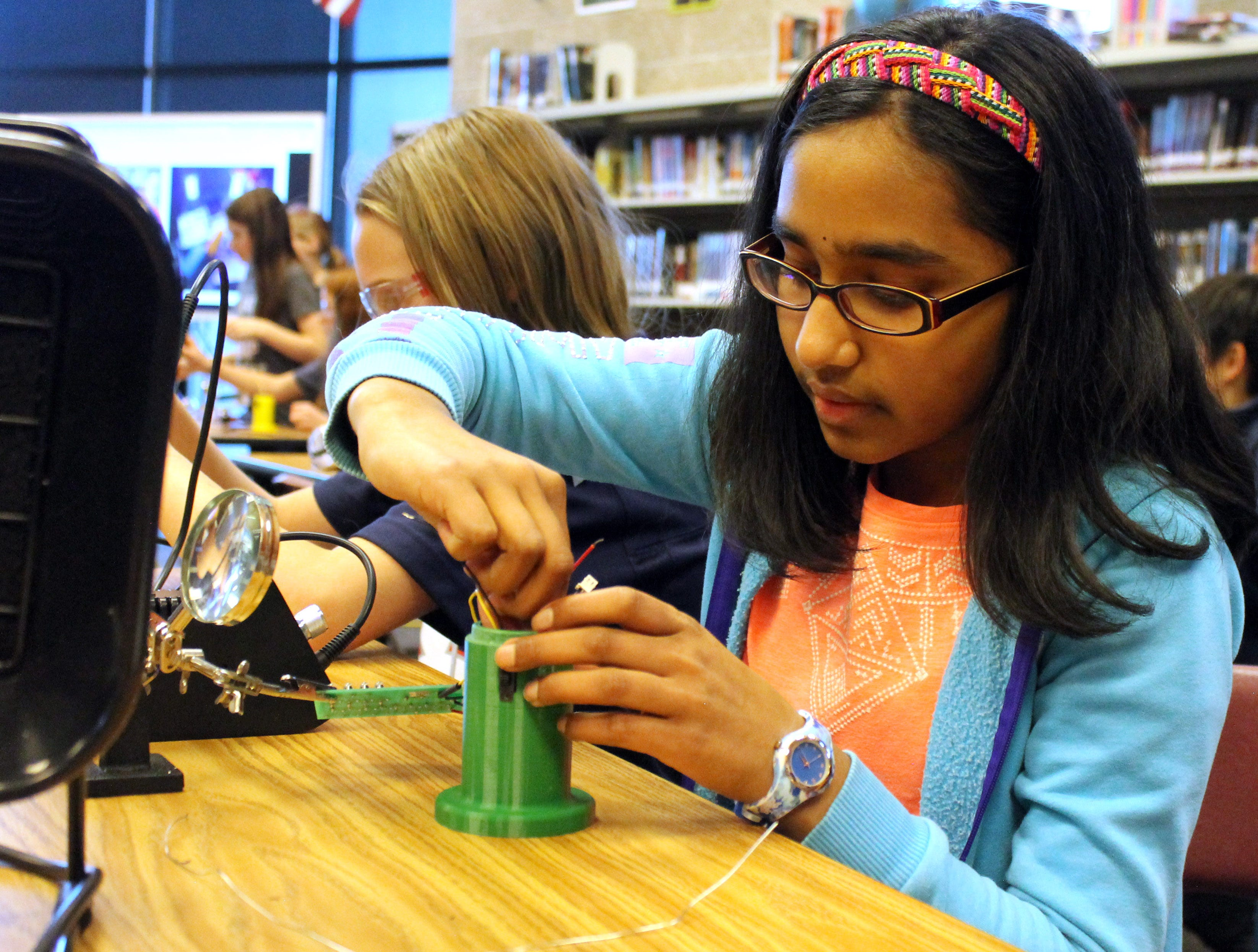 Niyati Kuntumalla, a seventh grader at Preston Middle School, helps her team engineer a working lantern after school Feb. 4, 2019. As part of Engineering Brightness, she helps to create 3D printed, sustainable lanterns and distributes  them to people without reliable electricity worldwide.