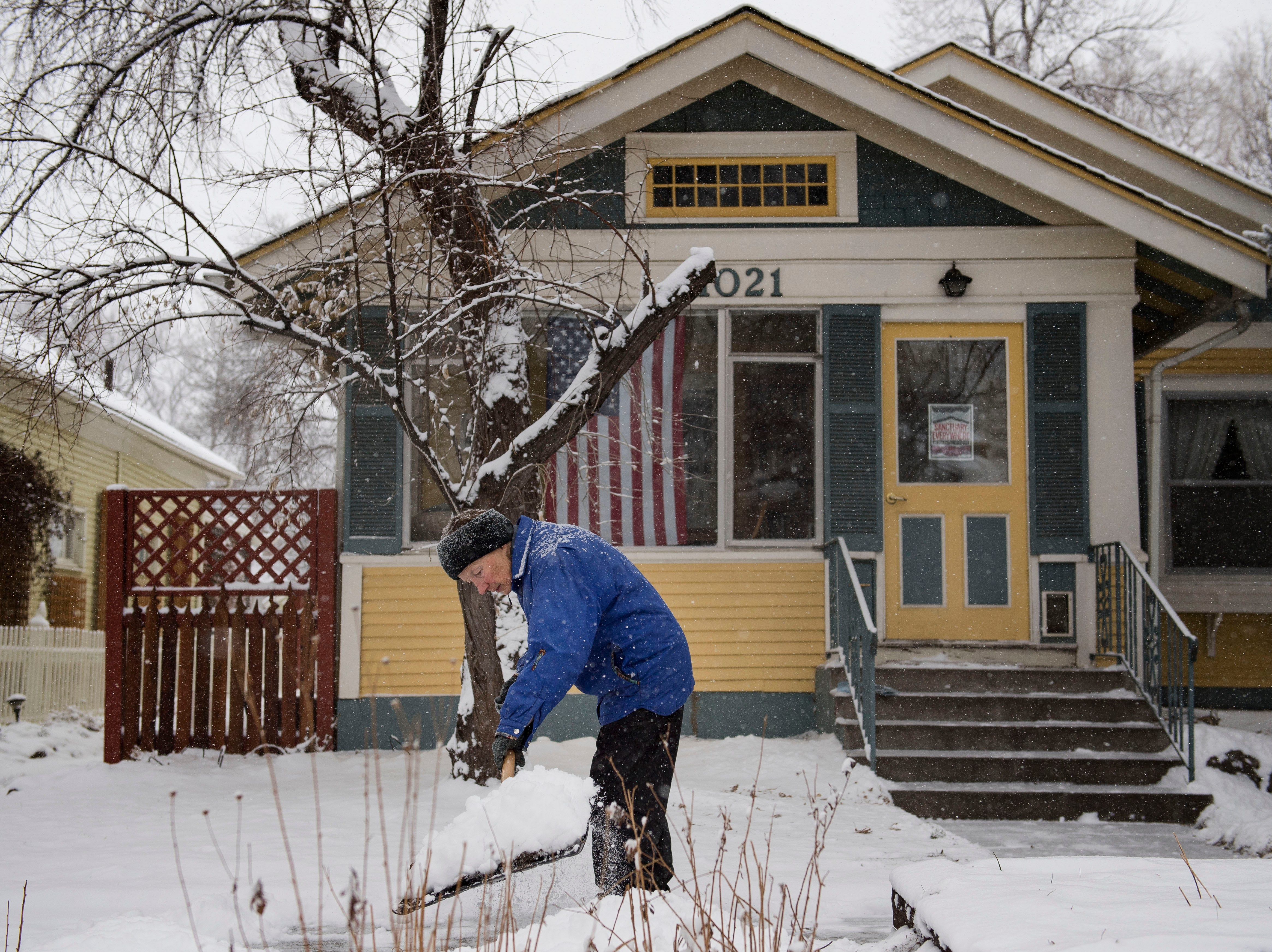 Miriam Beauman shovels the sidewalk in front of her home during a snowstorm on Wednesday, Feb. 6, 2019, in Fort Collins, Colo.