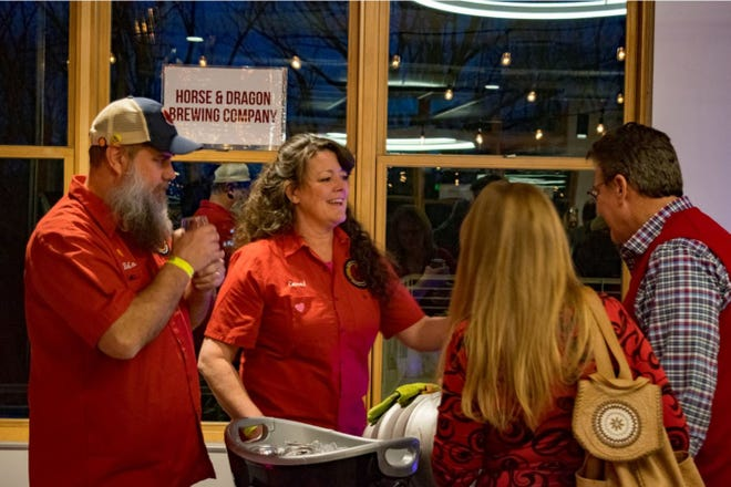 The owners of Horse & Dragon Brewing chat with attendees of the 2018 Summit Valentine's Day beer festival.