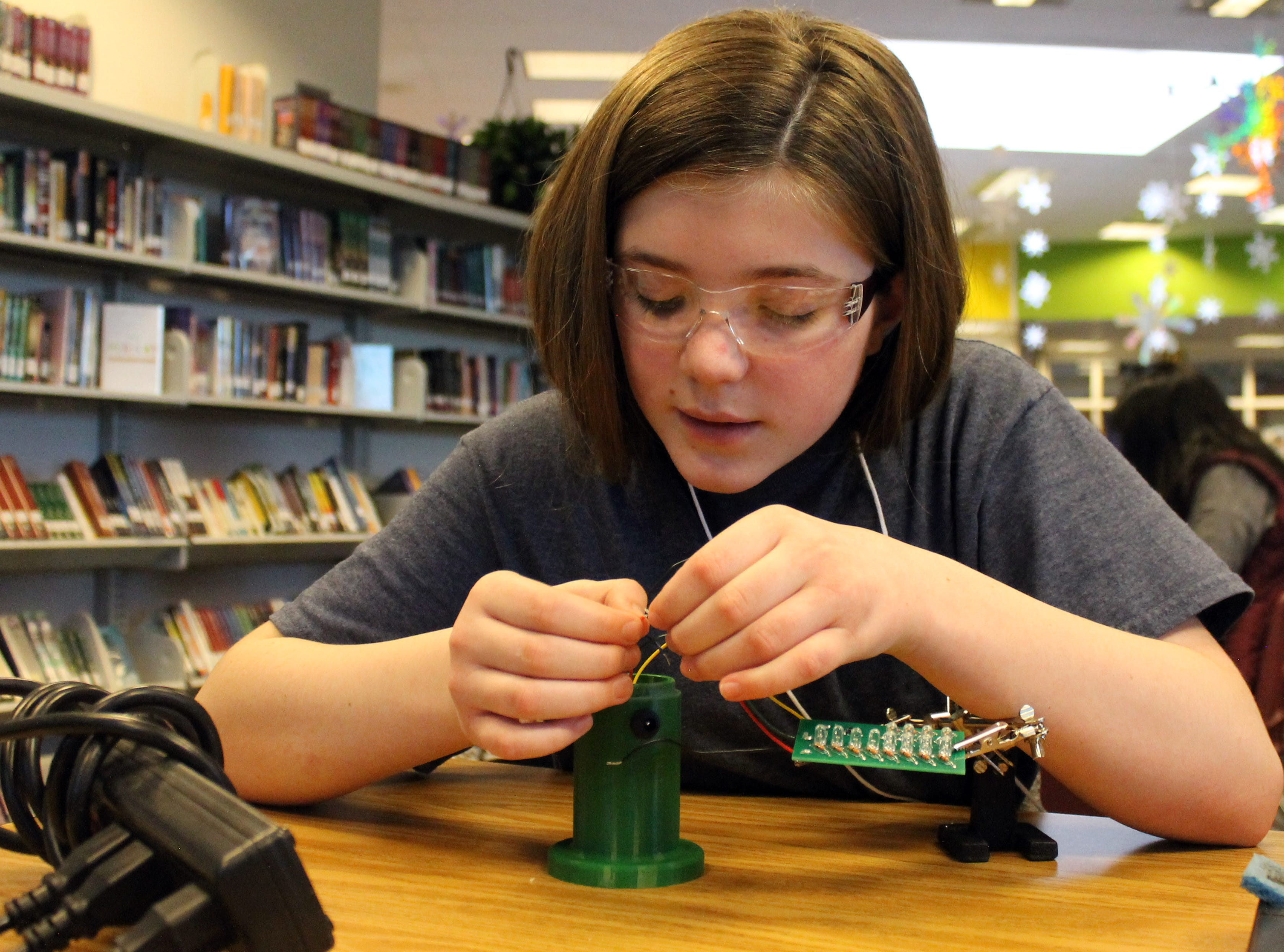 Dawn Farrer, a sixth grader at Preston Middle School, works to build a lantern for Engineering Brightness Feb. 4, 2019. She joined the club about three days prior. The group works to engineer 3D printed, sustainable lanterns and distributes  them to people without reliable electricity worldwide.