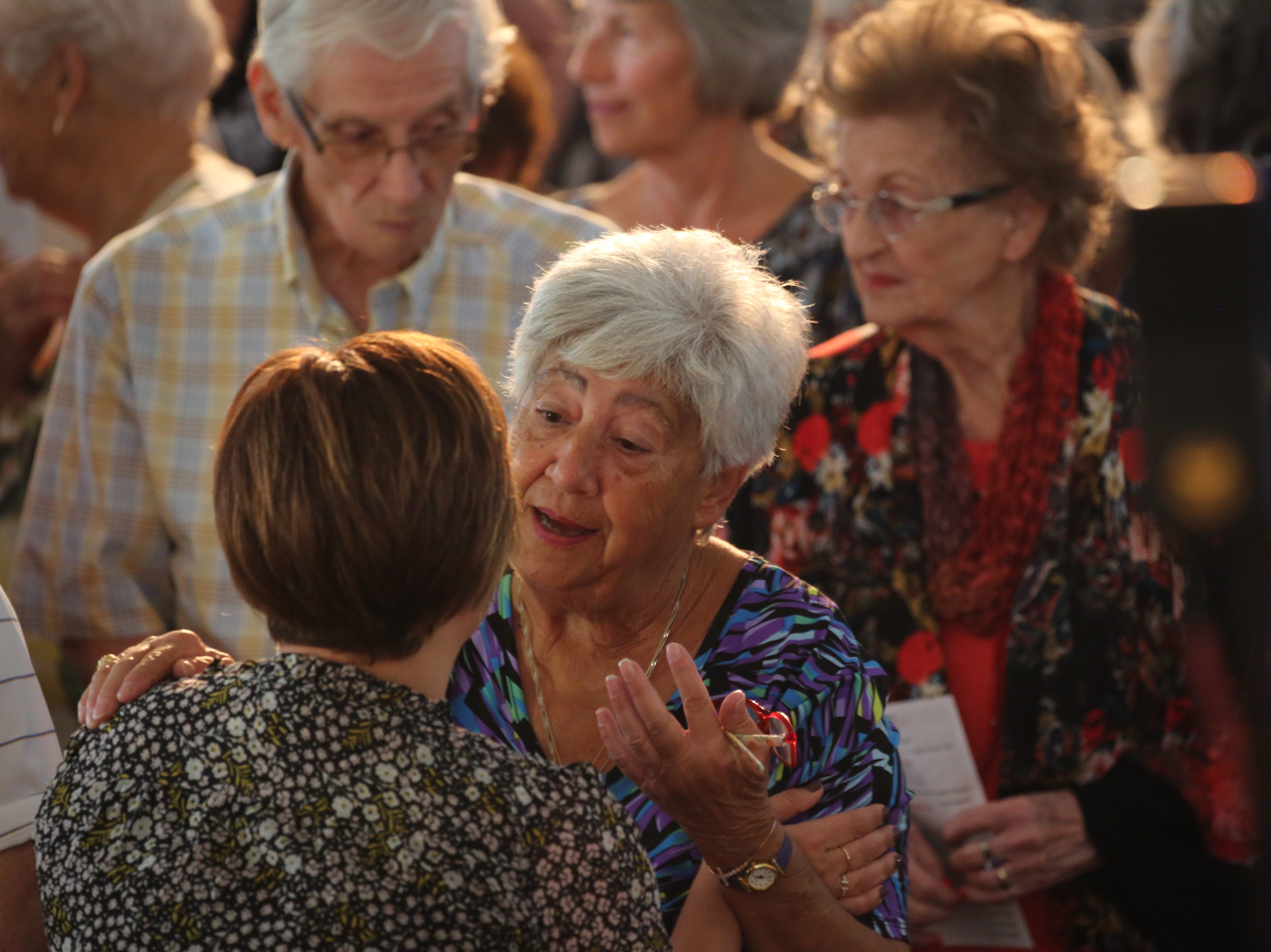 Roseanne Constantinople greets Tracey Galloway at the 30th Annual Mrs. Edison's Hymn Sing on Tuesday at First Presbyterian Church in Fort Myers.