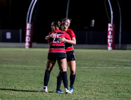 Makenzy Dupree is hugged by teammate Hailey Turner after scoring. Class 3A-Region 3 quarterfinal game between Naples and North Fort Myers girls soccer. Tuesday, February 5, 2019.