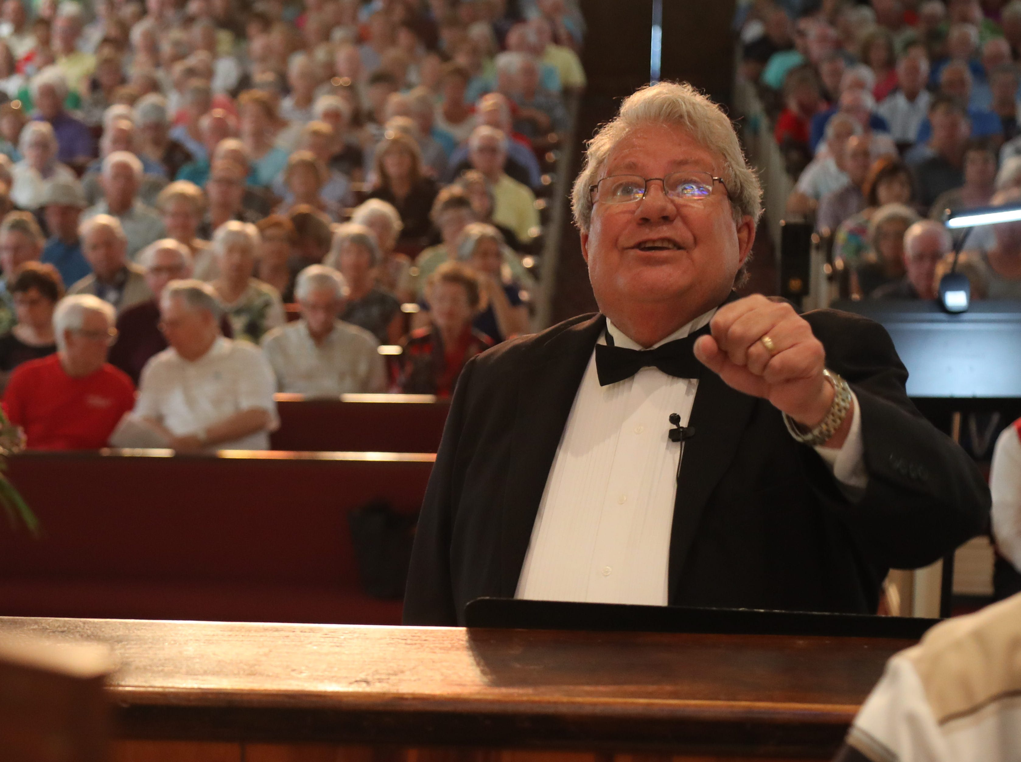 Roger Peterson leads the choir during the 30th Annual Mrs. Edison's Hymn Sing on Tuesday, February 5, 2019, at First Presbyterian Church in Fort Myers.